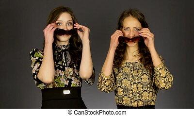 Two beautiful girls wearing sunglasses