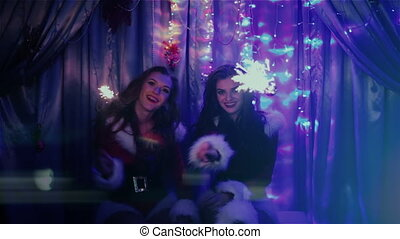 two beautiful girls with Christmas lights