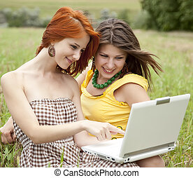 Two beautiful girls with notebook