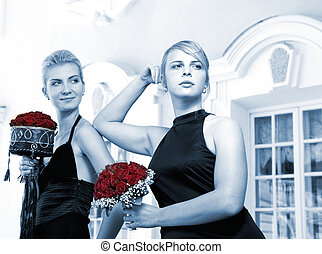 Two beautiful girls with red roses (toned in blue)