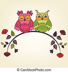 Two beautiful owls on a branch