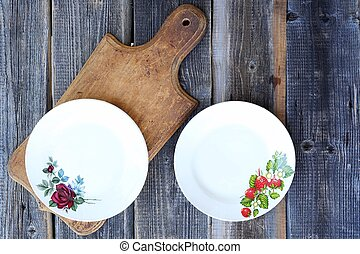 Two beautiful plates on wooden background