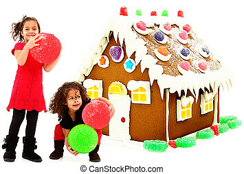 Two Beautiful Preschool African Hispanic Sisters Building Giant Gingerbread House over white background.