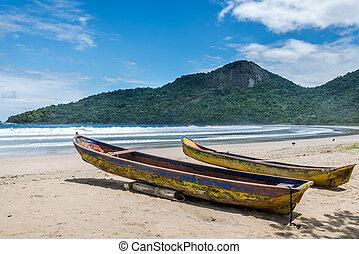 Two beautiful rustic fishing boats at Dos Rios beach, Ilha...