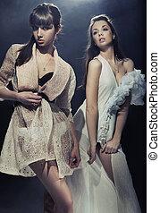 Two beautiful sensual girls posing