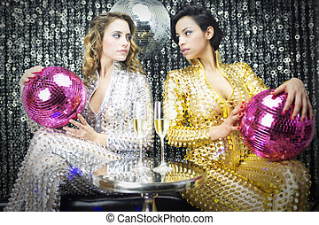 two beautiful sexy disco women in a bar lounge setting with...