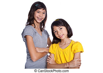Two beautiful sisters from Chinese and European background, isolated on white background