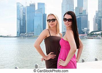 Two beautiful smiling women in Singapore