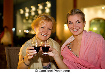 Two beautiful women celebrating