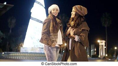 Two Beautiful Women Chatting