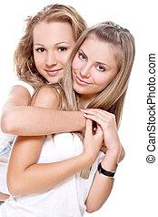 two beautiful women in a white T-shirts