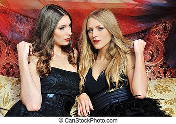 two beautiful women in oriental interior