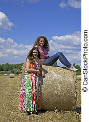 Two beautiful women on an agriculture field