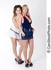 Two beautiful women posing together