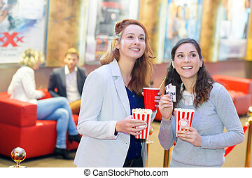 two beautiful young girls in the cinema