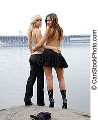 two beautiful young girls on the background of the river 6