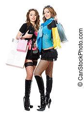 Two beautiful young women after shopping