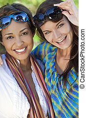 Two Beautiful Young Women Friends Laughing On Vacation