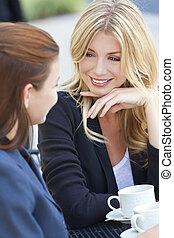 Two Beautiful Young Women Having Coffee
