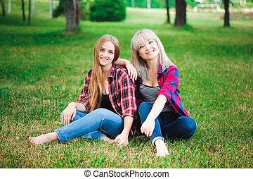 two beautiful young women having fun outdoors
