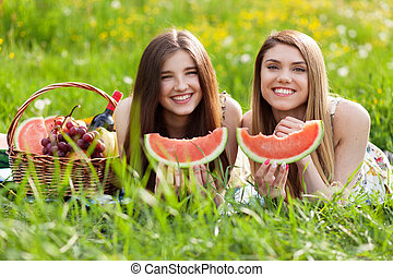 Two beautiful young women on a picnic