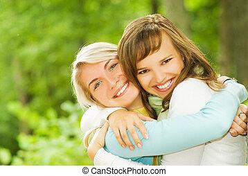 Two beautiful young women outdoors