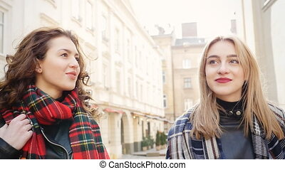 Two Beautiful youngs women with sunglasses walking in the city.