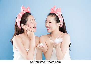 two beauty woman with make up concept on the blue background