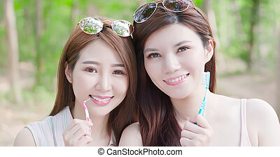 two beauty women smile happily - two beauty women wear brace...