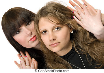 Two beauty young embracing women. Isolated 2