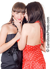 Two beauty young women. Isolated on a white background