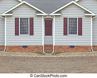 Two bedroom windows in a vinyl sided house with a curtains in them on a brick foundation along with gutters on both sides with room for your text.