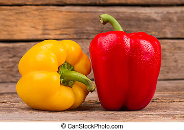 Two bell peppers, yellow and red.