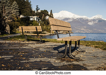 two benches in front of a lake