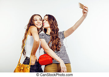 two best friends teenage girls together having fun, posing emotional on white background, besties happy smiling, lifestyle people concept