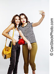 two best friends teenage girls together having fun, posing emotional on white background, besties happy smiling, making selfie, lifestyle people concept