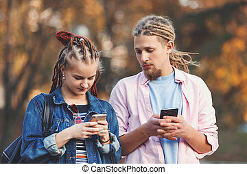 Two Best Friends With Dreads Chatting On The Smartphones