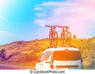 two bicycles fixed on the roof of car. Concept: tourism, outdoor activities, traveling