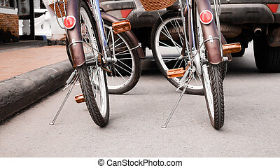 Two bicycles on street.