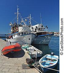 fishing boats - two big and three small fishing boats ...