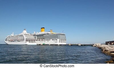 two big passenger ships stand nearby with each other on...