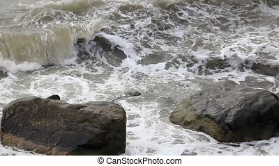 Two big stones in the waves