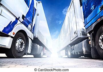 Two big trucks. Wide angle view.