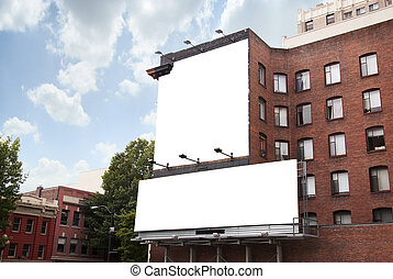 Two Billboards on Brick Building - Two blank white...