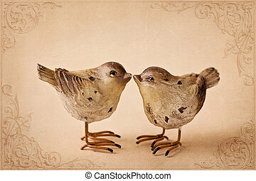 Two birds on brown background