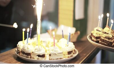 Two birthday cakes with sparklers at children s fair