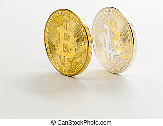 Two bitcoins one silver and the other gold