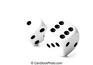 Two black and white dices against a white background