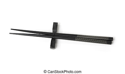 Two black chopsticks isolated
