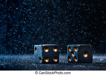 Two black dices on a blue background. The concept of...